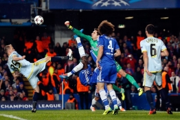 Chelsea's Demba Ba challenges Steaua Bucharest's goalkeeper Ciprian Tatarusanu during their Champions League soccer match.