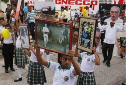 Residents hold portraits during a symbolic public funeral for Gabriel Garcia Marquez in Aracataca.