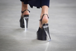 A model walks in a broken shoe as she presents a creation from the Calvin Klein Spring/Summer 2015 collection during New York Fashion Week.