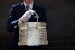 An employee holds an Hermes diamond and Himalayan Nilo Crocodile Birkin handbag at Heritage Auctions offices in Beverly Hills.