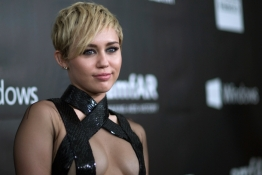 Miley Cyrus poses at the amfAR's Fifth Annual Inspiration Gala in Los Angeles.